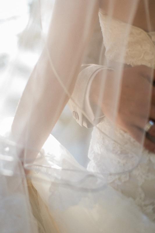 Groom holding bride around the waist