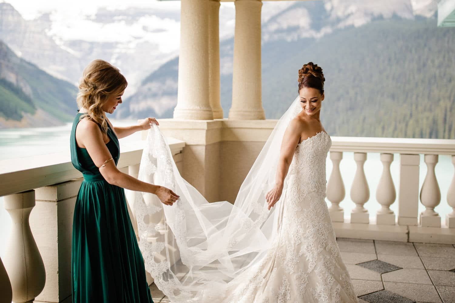 Bride getting ready with Lake Louise in the background