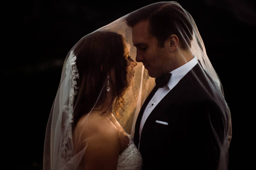 A close-up photograph of a bride and groom in Banff after their wedding celebration at the Banff Springs Hotel