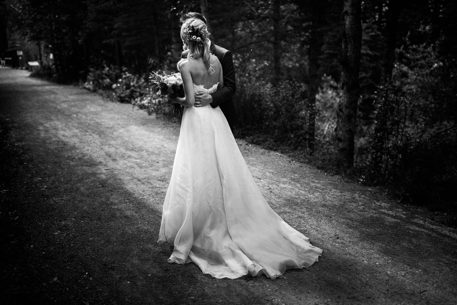 Bride and Groom walking in Canmore