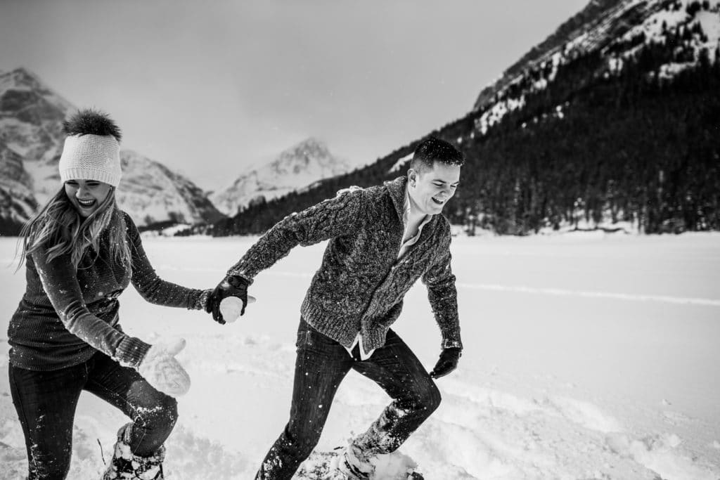 Engagement photo of an engaged couple in snow shoes during the winter months in Kananaskis Country