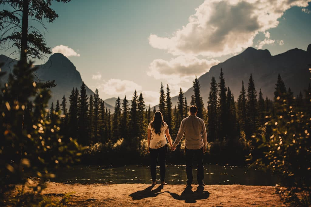 CanmoreEngagement photographer Geoff Wilkings Photography photographs an engaged couple in the summer in Canmore surrounded by the Canadian Rockies