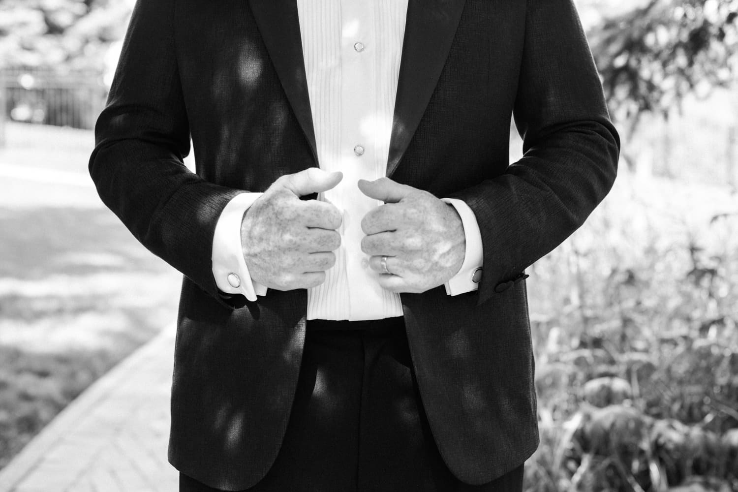 Groom getting ready photo, black and white image of a groom in a tux