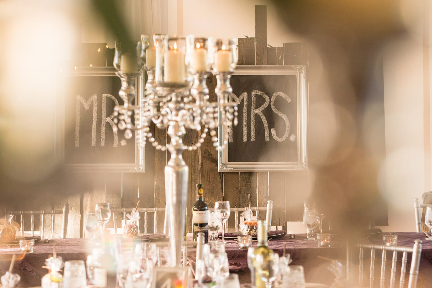 Wedding venue with a chandelier and chalkboard signs