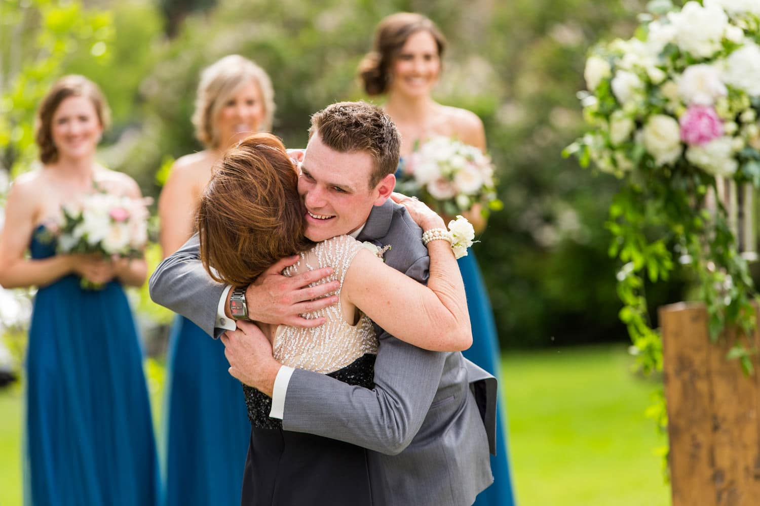 Calgary Wedding Photographers Groom Hugging Mom