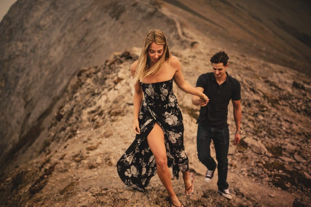 Ha-Ling engagement photograph located in Canmore Alberta of a couple walking up the mountain