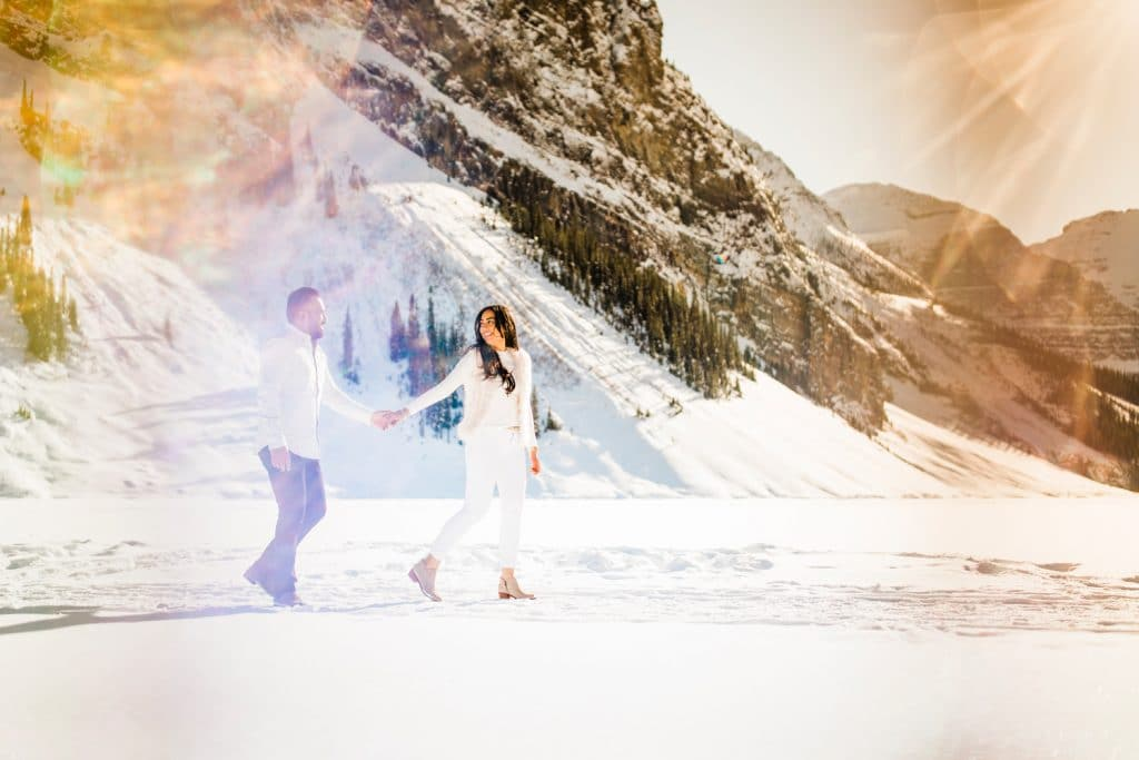 Winter engagement shoot located on a frozen Lake Louise during a gorgeous winter sunny day