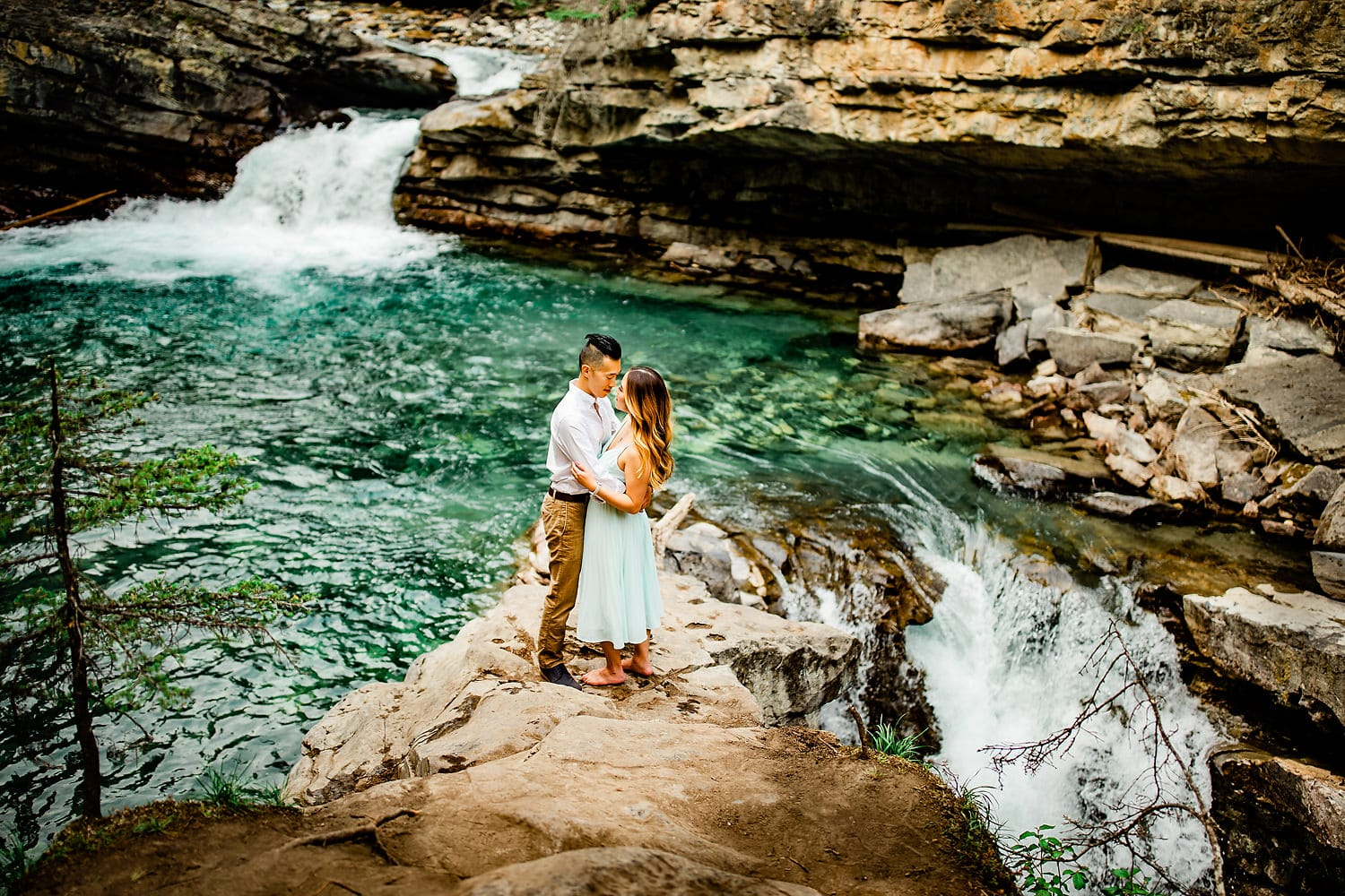 Johnston Canyon engagement session of a engaged couple embracing each other.