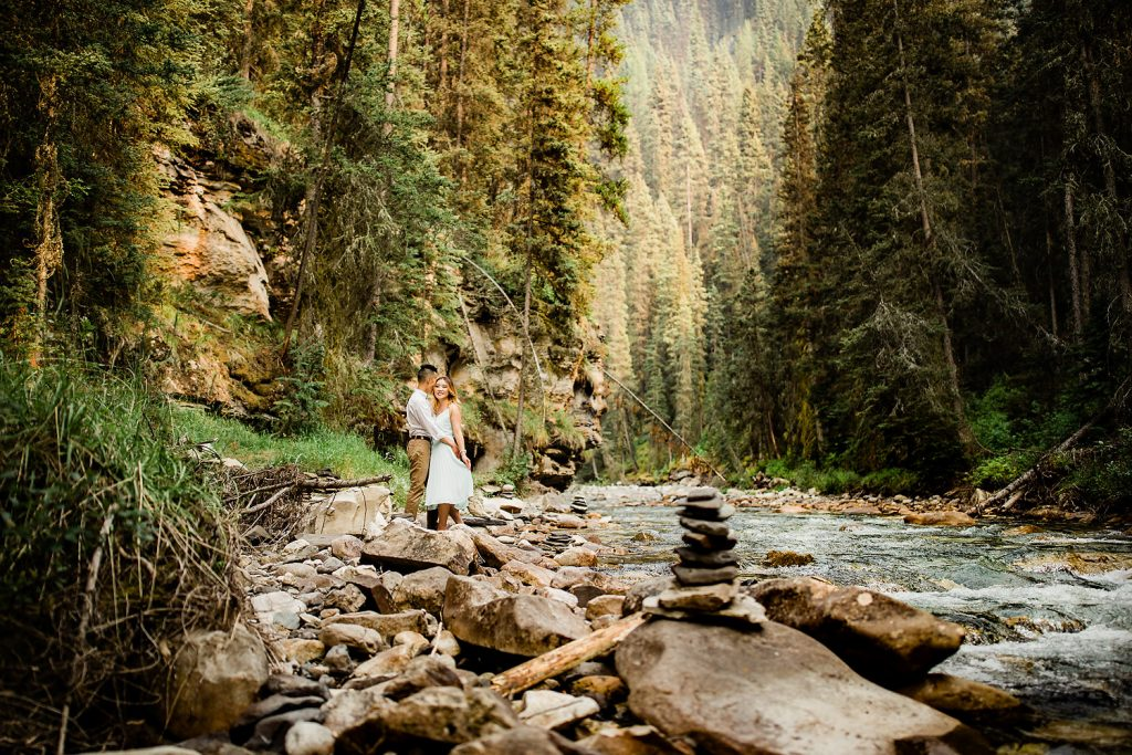 A hike in Johnston Canyon during an engagement session mid summer in Banff National Park