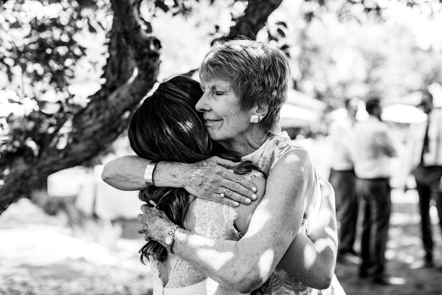 mom daughter hugging on wedding day by Calgary wedding photographer