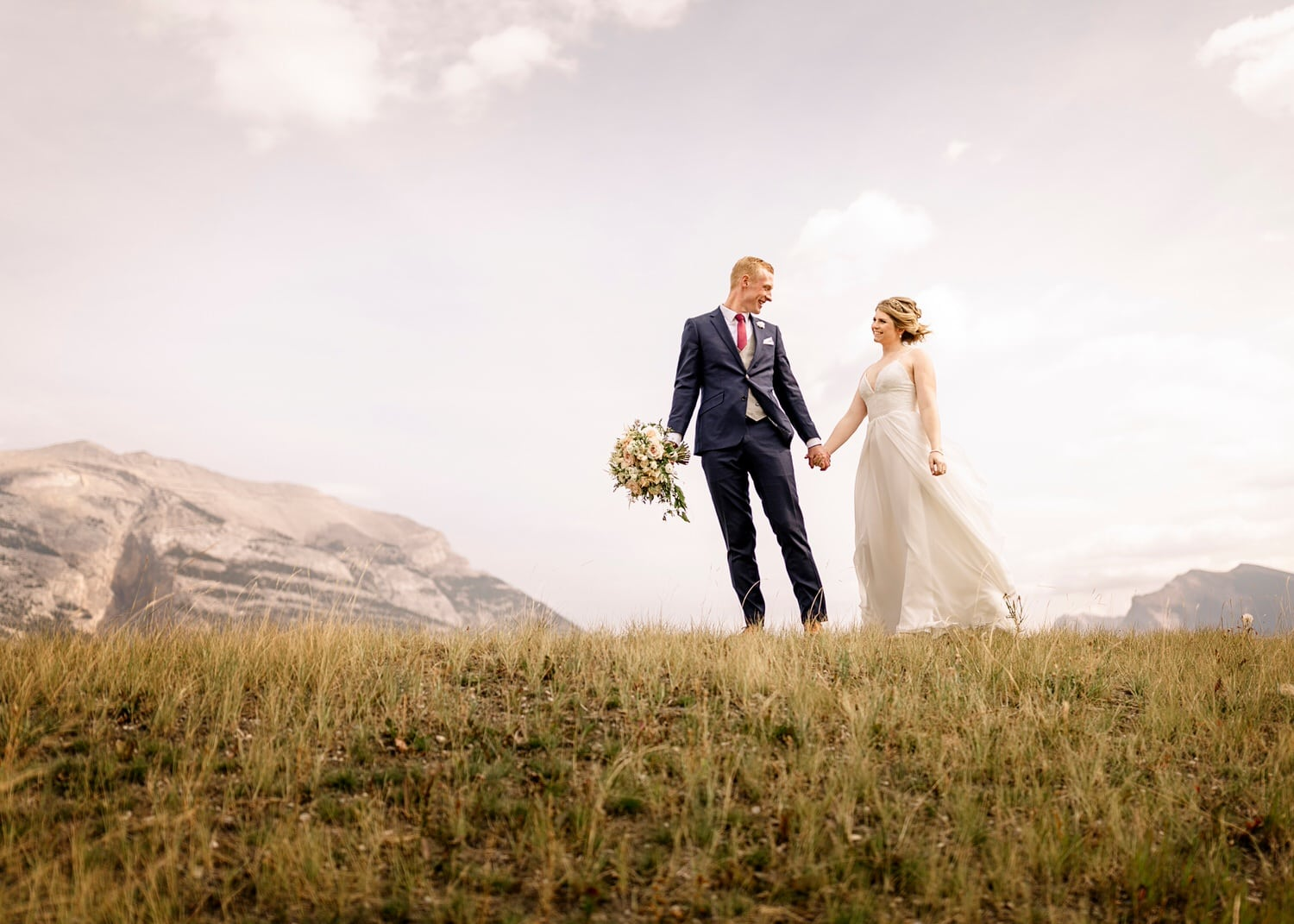 A couple walking in Canmore after getting married