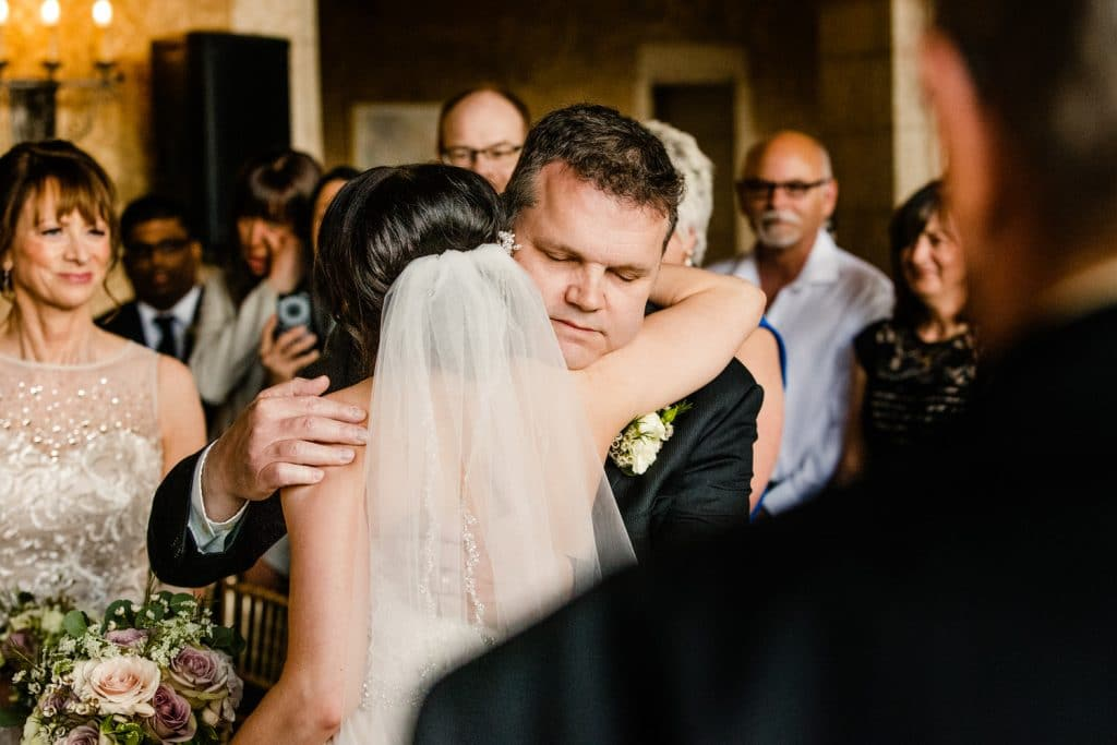 Bride and bride's dad hugging during the ceremony at the Banff Springs Hotel