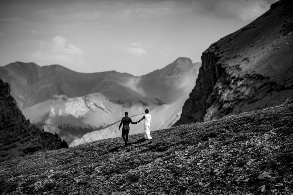An epic photograph in Canmore during a helicopter mountain wedding within the Canadian Rockies
