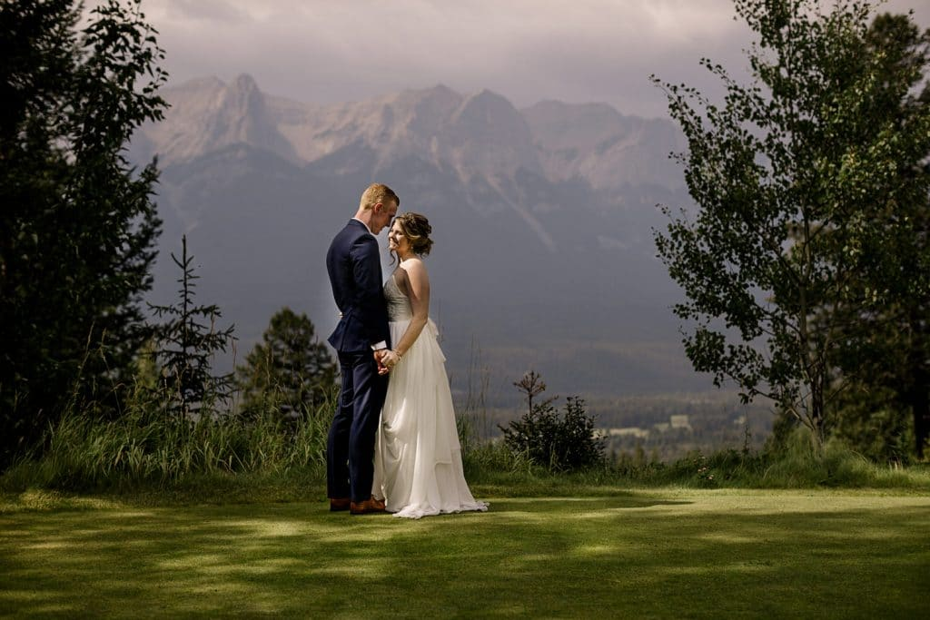 First look photograph of a bride and groom at Canmore Silvertip Canmore by a Canmore wedding photographer
