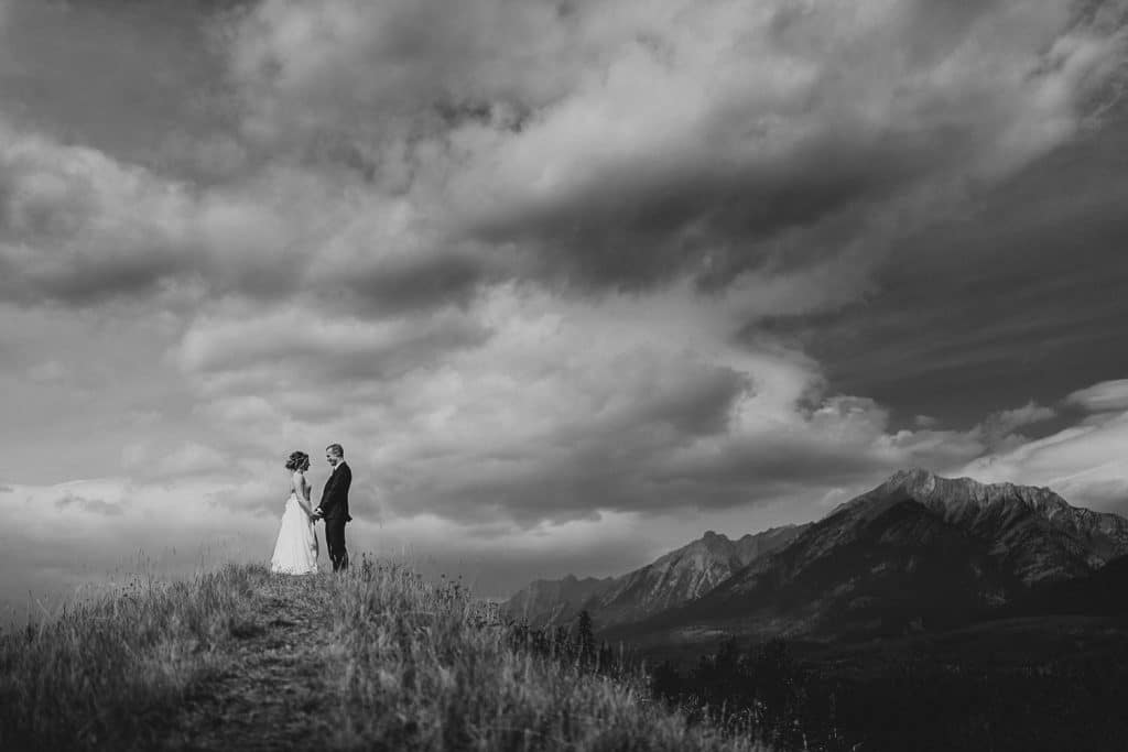 Black and white photograph of a bride and groom together in Canmore after getting married at Silvertip Resort in Canmore Alberta
