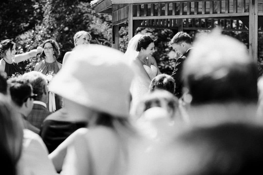 Canmore Silvetip Resort Gazebo wedding photograph of a bride groom saying their vows to each other