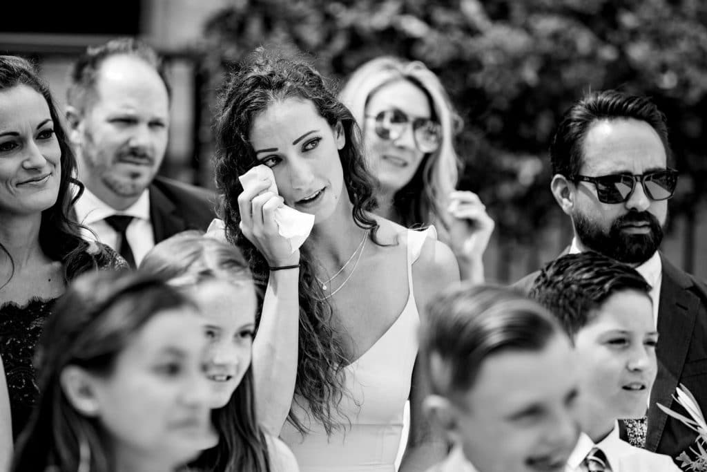 Family member cries during an emotional Banff Springs Hotel wedding ceremony from Banff wedding photographer