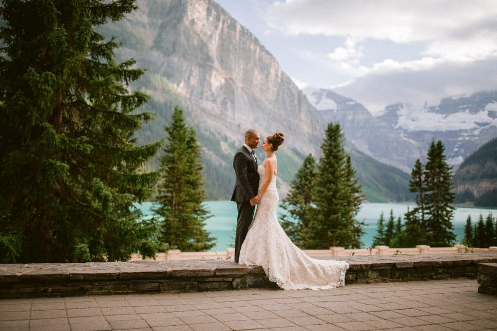 Bride and groom standing outside the Victoria Ballroom in Lake Louise