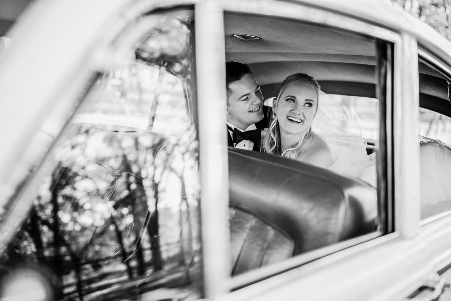 A Rolls Royce Calgary wedding vintage vehicle with a bride and groom inside