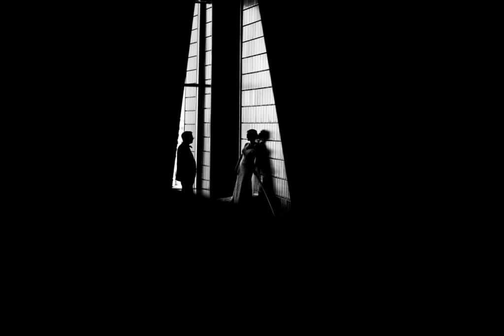 A wedding photograph of a bride and groom inside the Studio Bell Max Building Downtown Calgary by Calgary wedding photographer Geoff Wilkings Photography