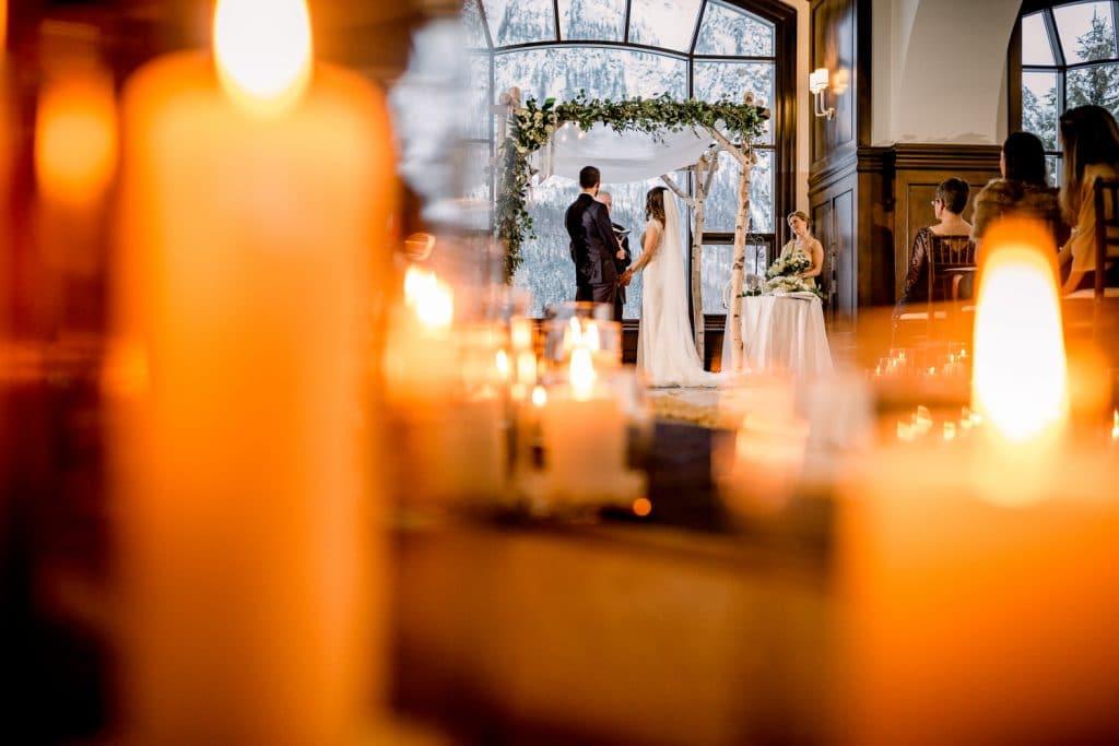 Candle lit Chateau Lake Louise wedding ceremony