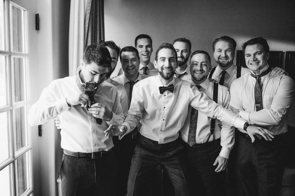 Lake Louise wedding photographer photographed the groom and his bridal party getting ready and laughing