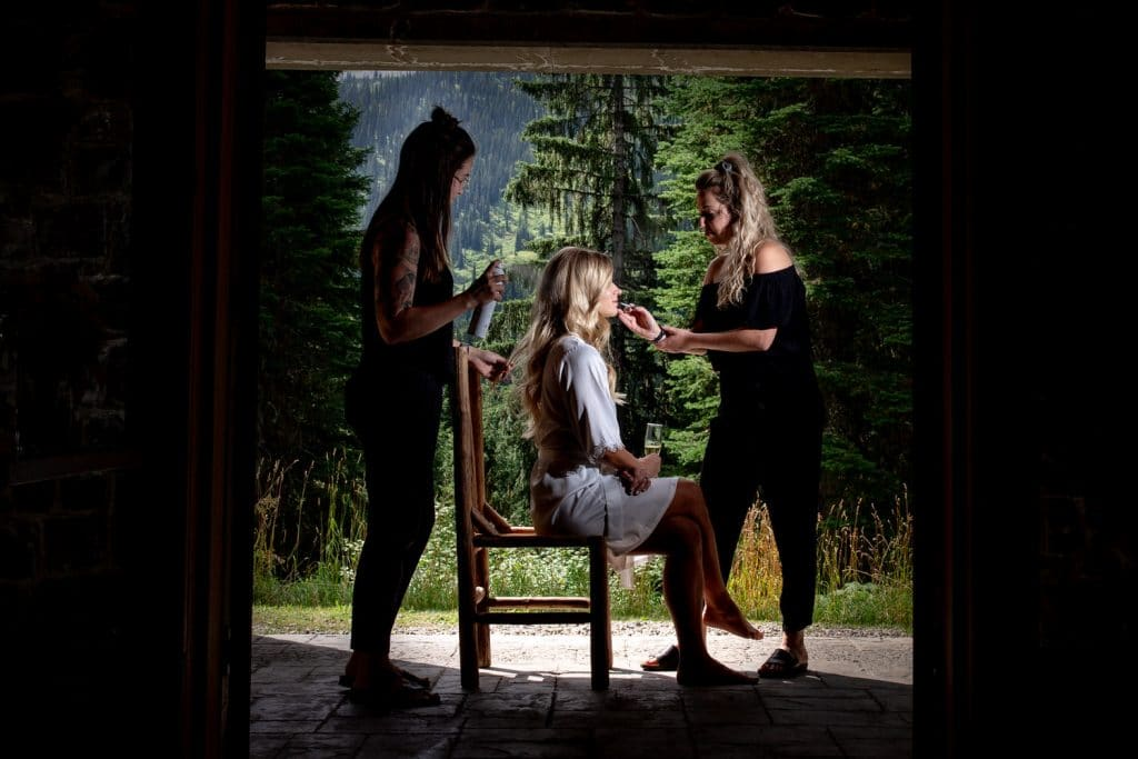 bridal getting ready preparation photograph in Fernie BC British Columbia before her wedding ceremony