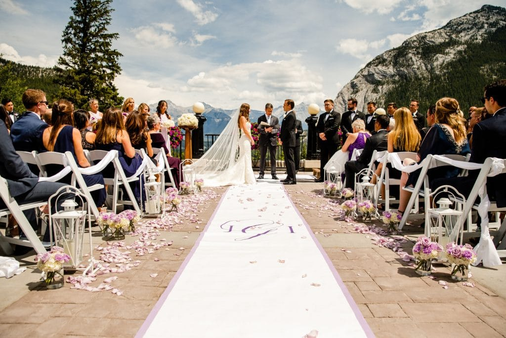 Banff Springs terrance wedding ceremony during the summer months photographed by Calgary wedding photographer Geoff Wilkings