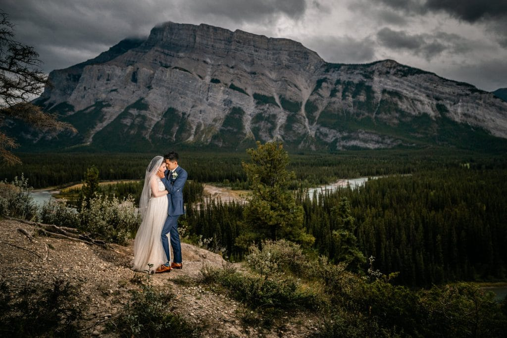 A Banff Wedding with Mt Rundle in the background with the turquoise coloured water of Bow River flowing