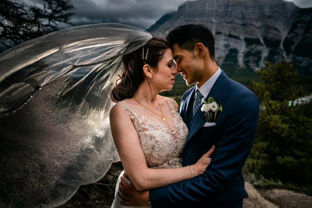 Banff wedding photograph of a bride and groom together with Mount Rundle in the background