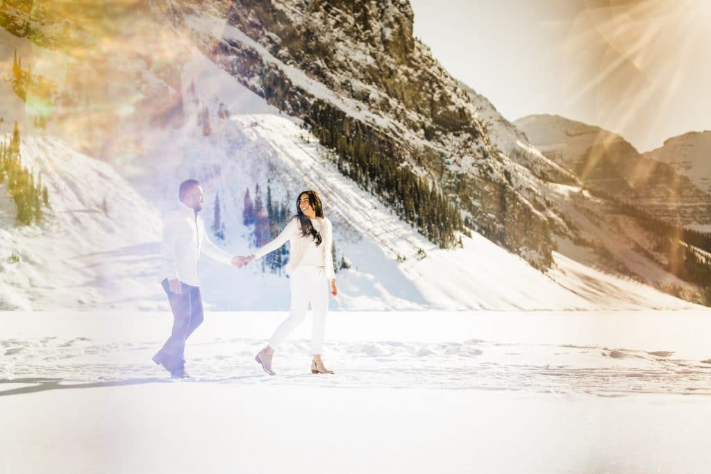 Frozen Lake Louise winter engagement shoot by Victoria Glacier