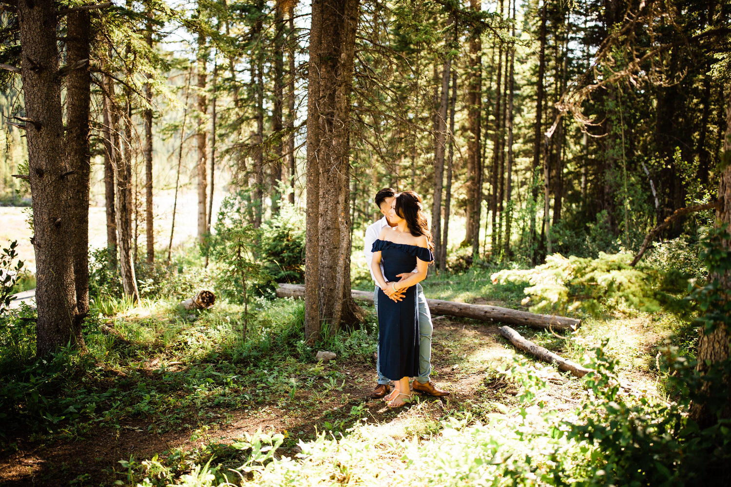 Engagement photos at Elbow Falls in the woods along the river
