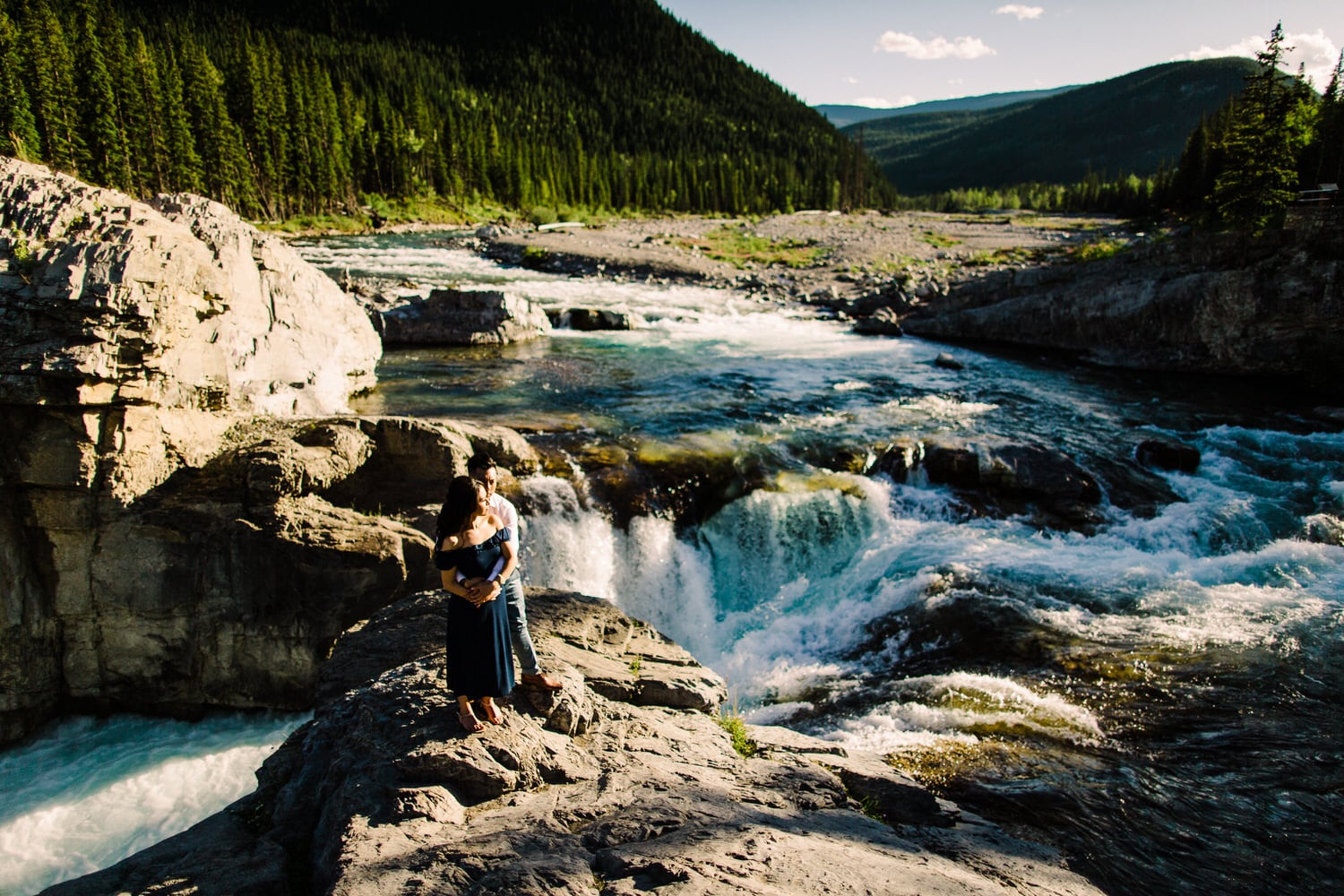 Engagement Photo of a Couple Standing Next to Elbow Falls