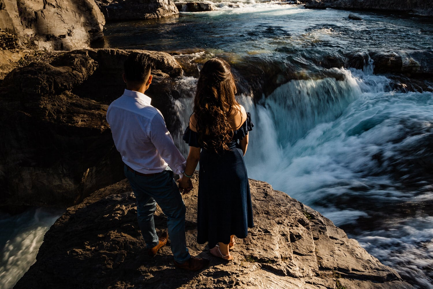 Elbow Falls Engagement Photo of a Couple Overlooking the Falls