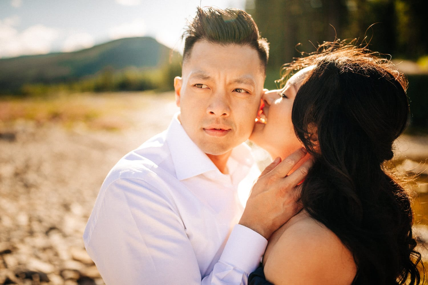 Unposed engagement photo with a couple whispering