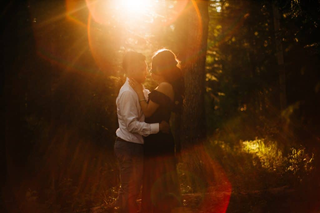 Calgary engagement photographer Geoff Wilkings captured an engaged couple at Elbow Falls during a warm summer evening