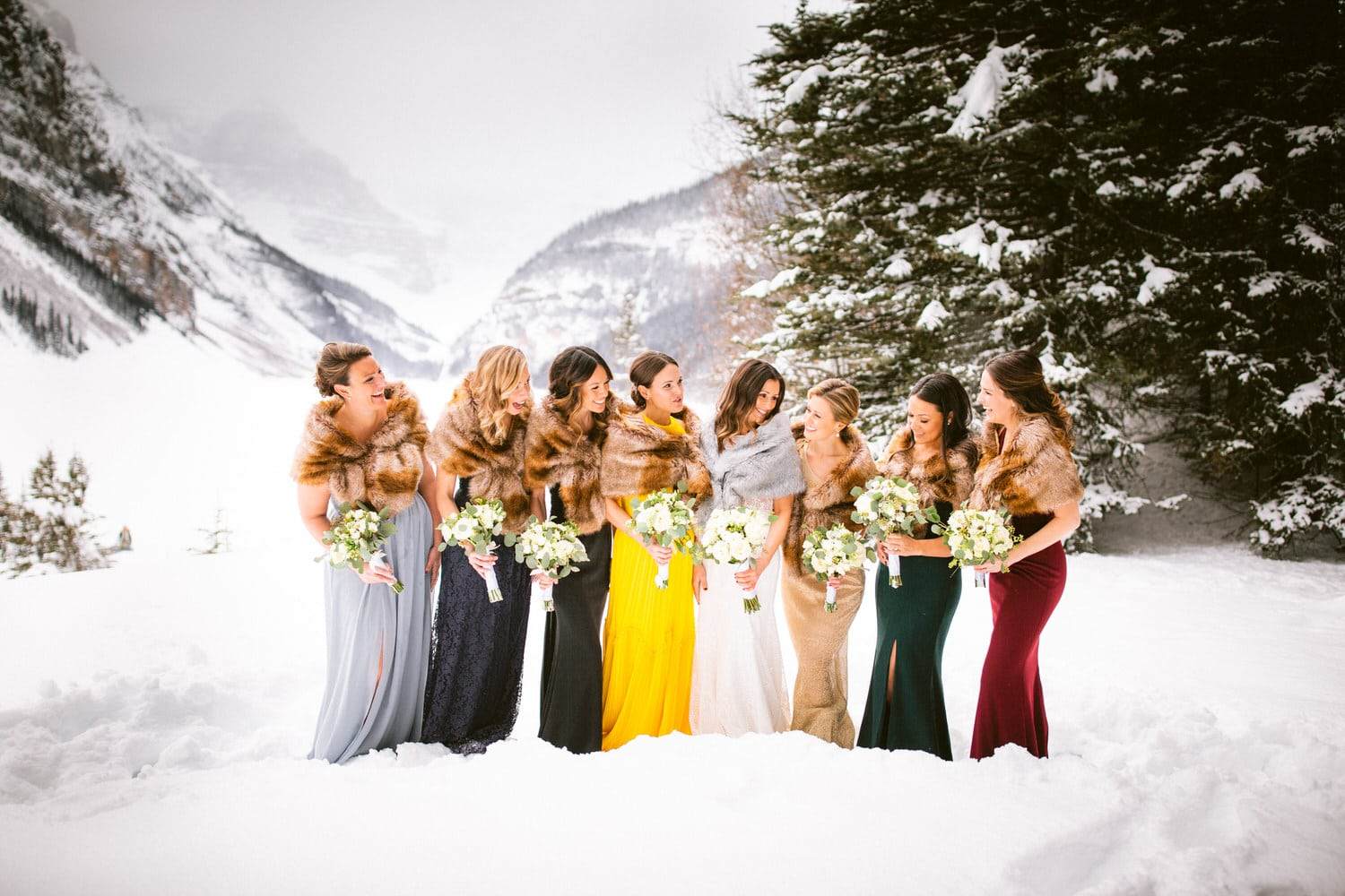 Winter photograph at Lake Louise wedding photographer and a bridal party
