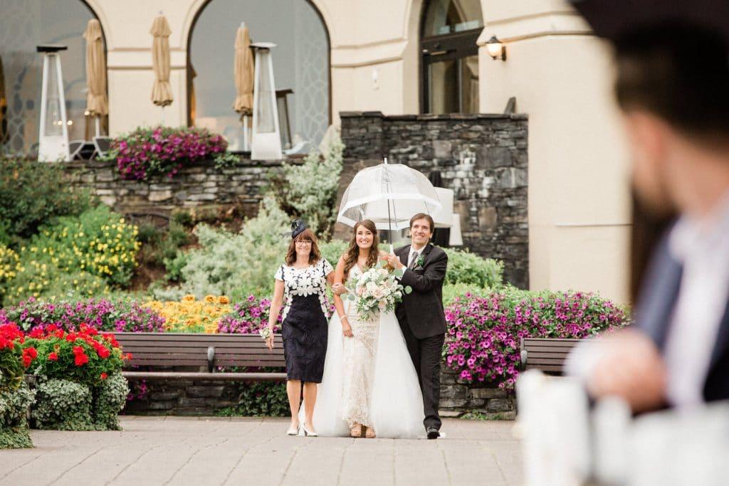 bride walking down the aisle towards her groom
