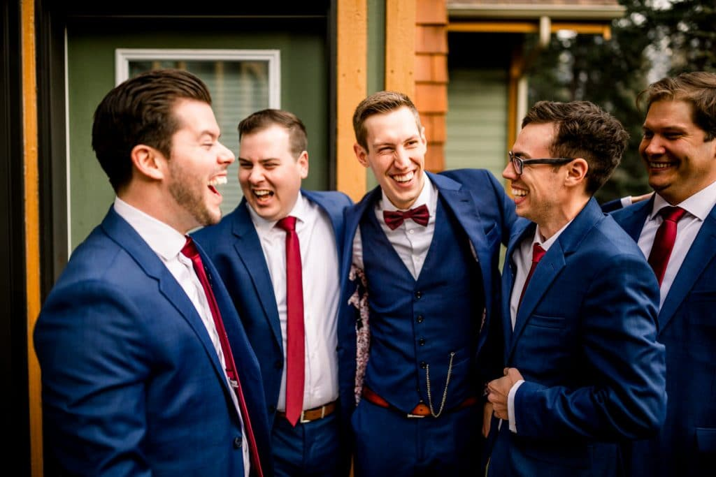 Bridal Party photographs Groomsmen and Groom laughing in Canmore at a private home