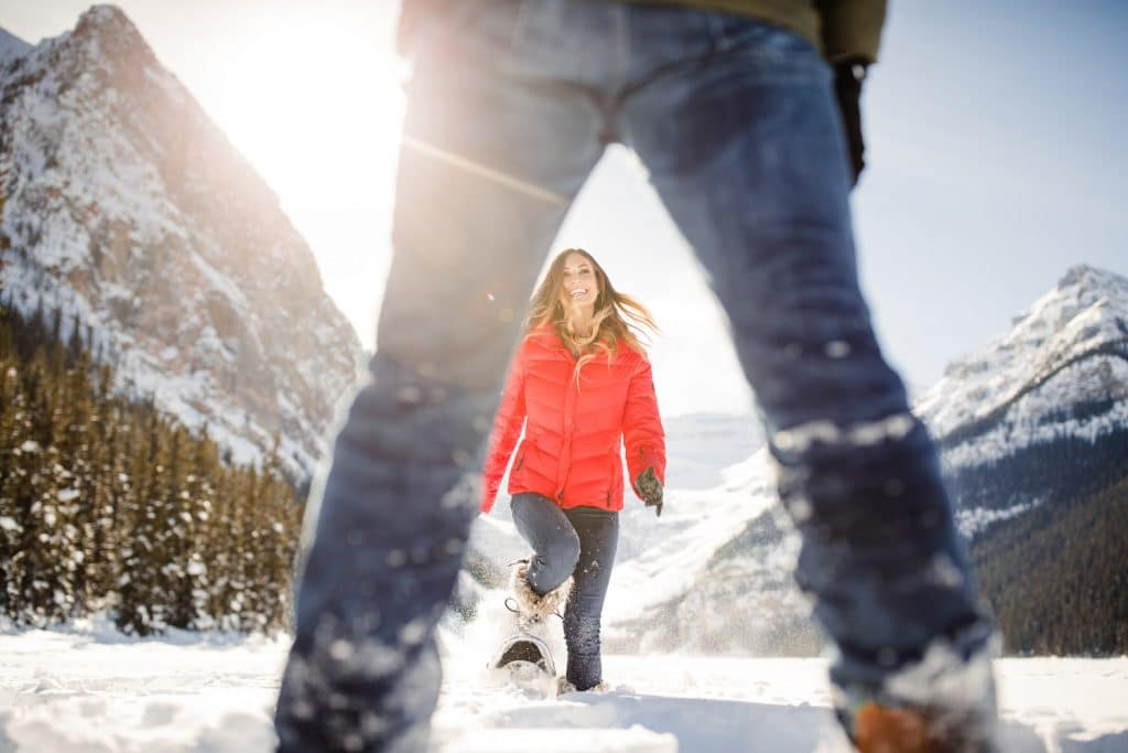 Lake Louise engagement photo of a couple on a frozen Lake Louise