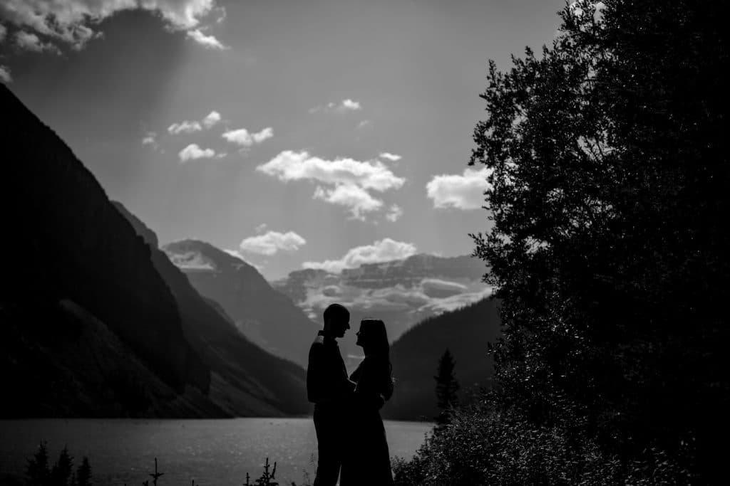 summer engagement photograph of an engaged couple at Lake Louise with Victoria Glacier behind them