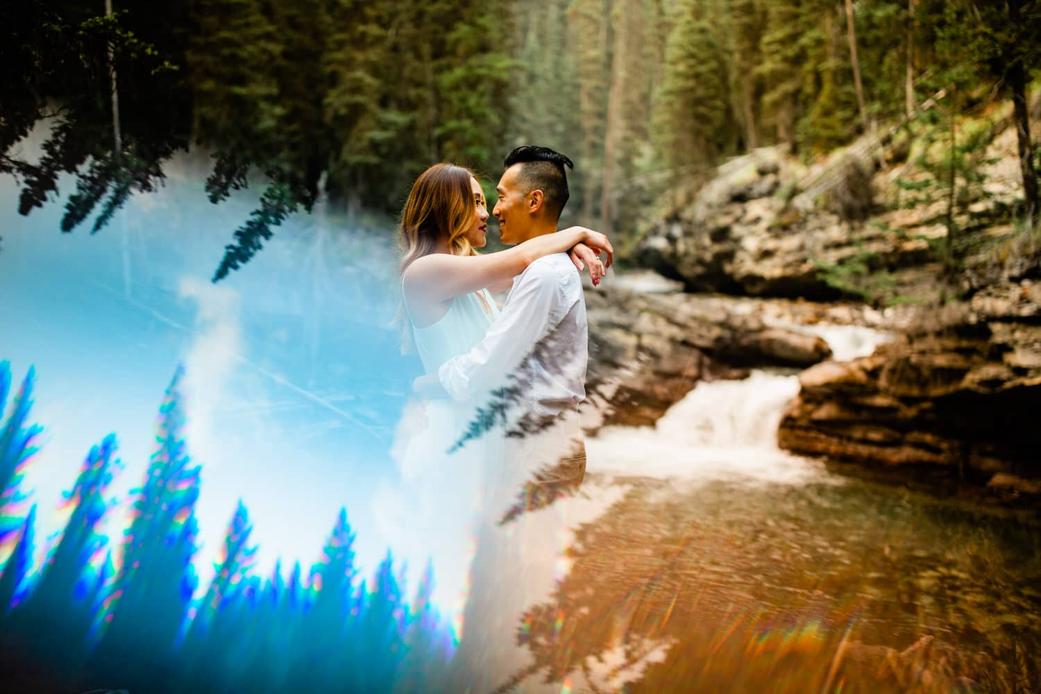 A couple holding each other during an engagement shoot in Banff