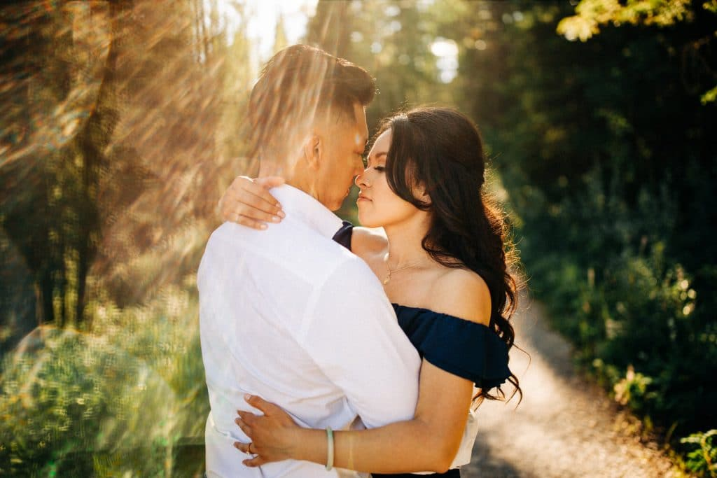 A newly engaged couple holding each other during an engagement shoot.