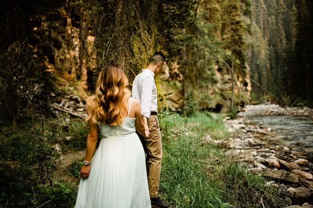 An engaged couple walking together