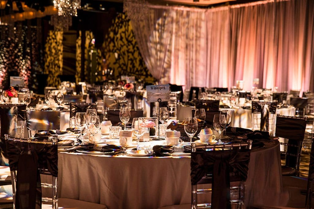 A reception wedding venue at Hotel Arts decorated with professional lighting
