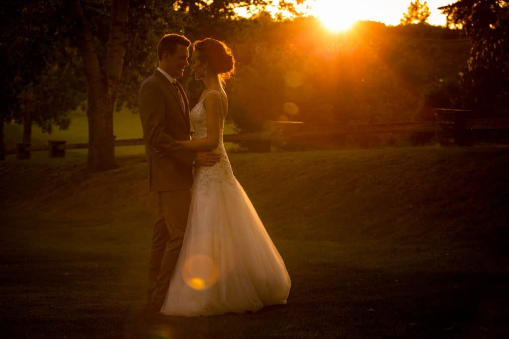 A sunset photo of a bride and groom at Sirocco Golf Club in Calgary
