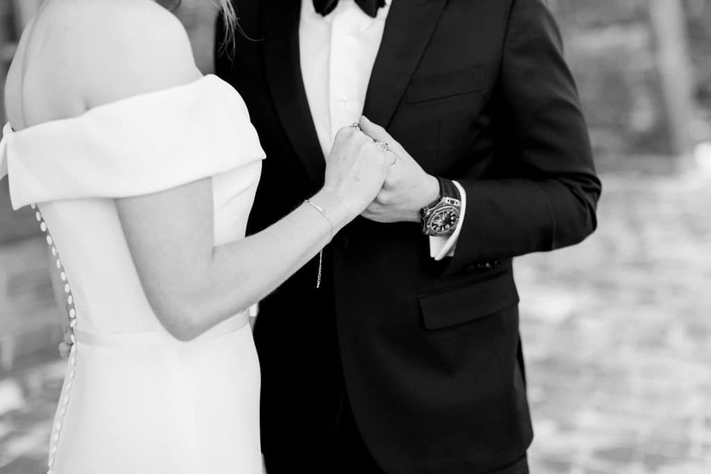 Bride and groom holding hands at Azuridge Estate Hotel by Calgary wedding photographer