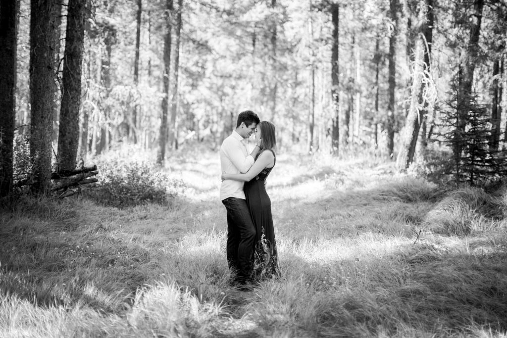 Wooded Banff engagement photo of a couple holding each other