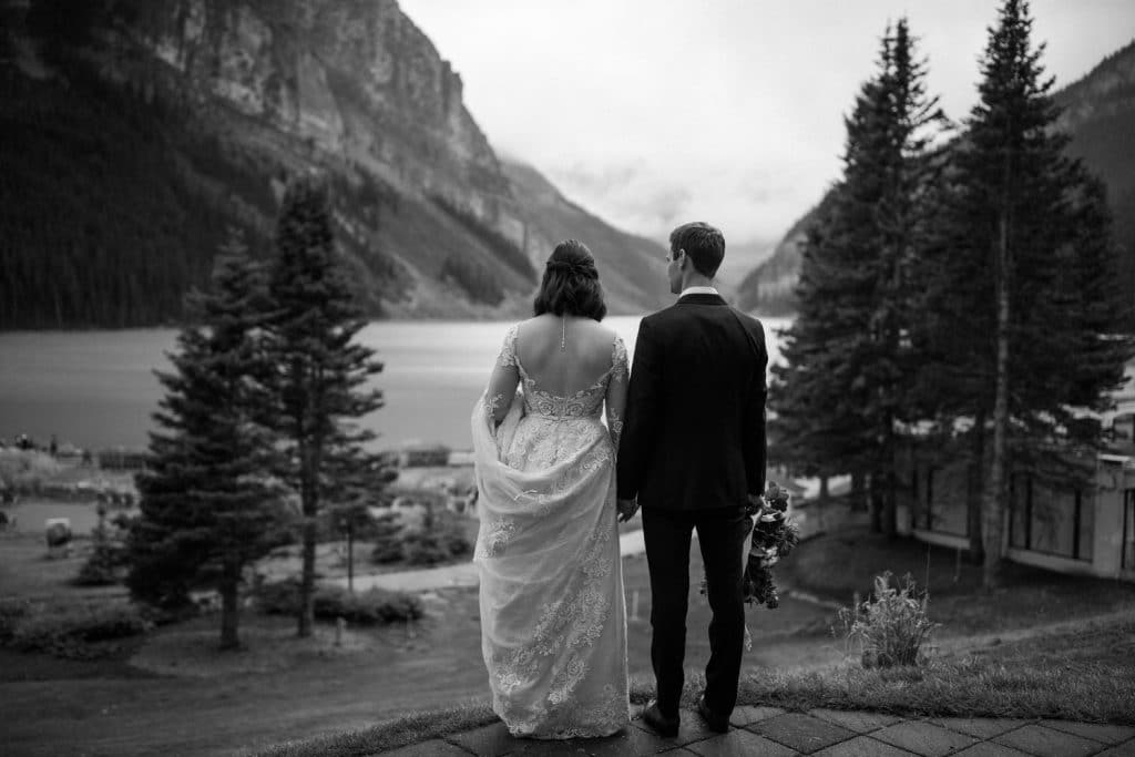 Evening photograph of a bride and groom when they stepped out of their wedding reception at Chateau Lake Louise Victoria Ballroom