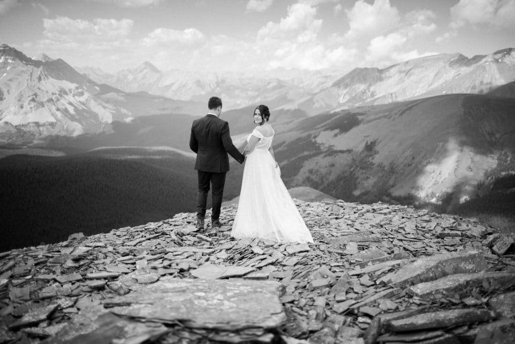 Hand in hand Geoff Wilkings Photography bride and groom walk towards their private mountain top wedding ceremony location